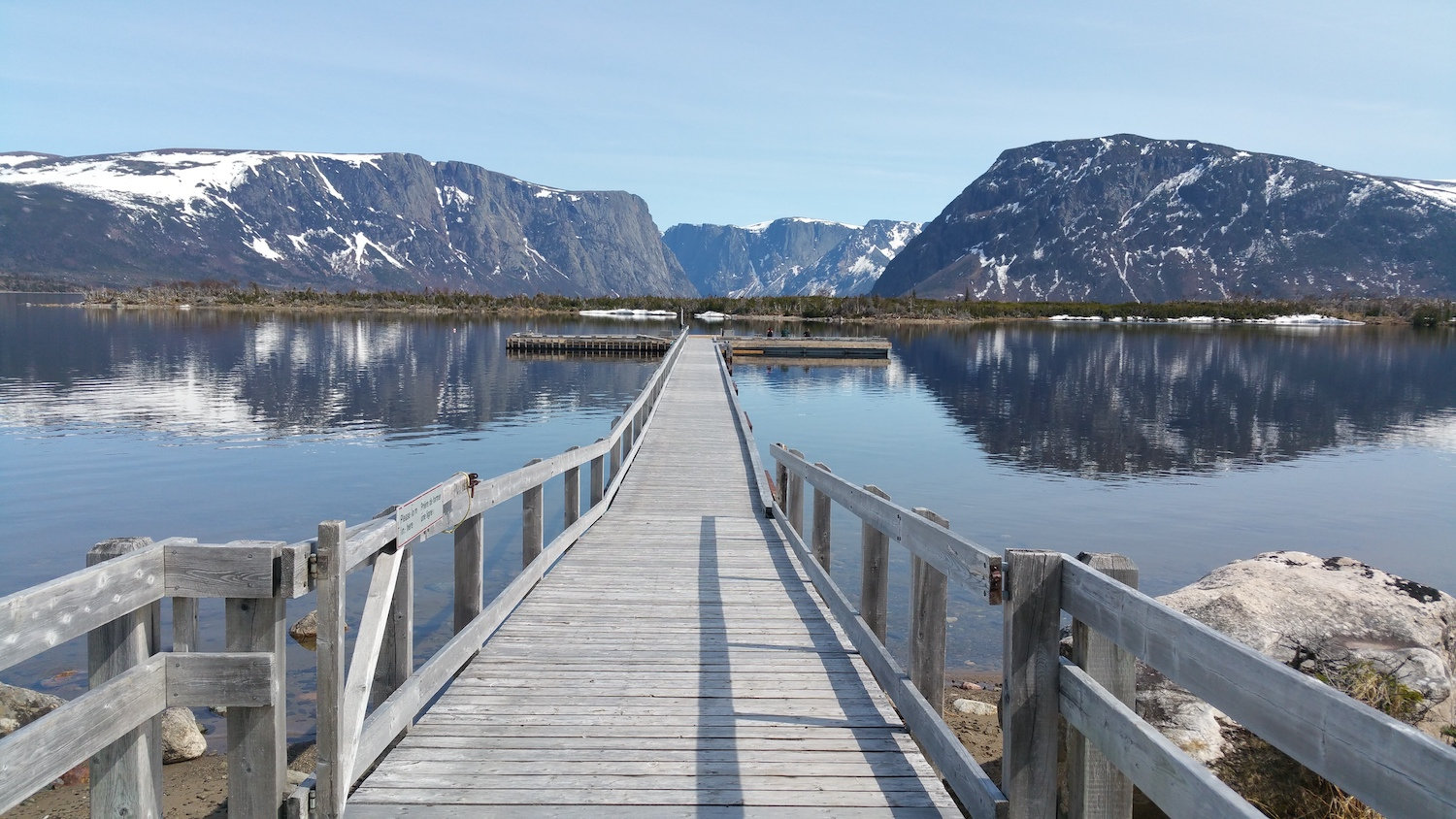 """Boardwalk into Western Brook Pond with mountains in Gros Morne National Park, Newfoundland"" By Julie A Lynch via Shutterstock"