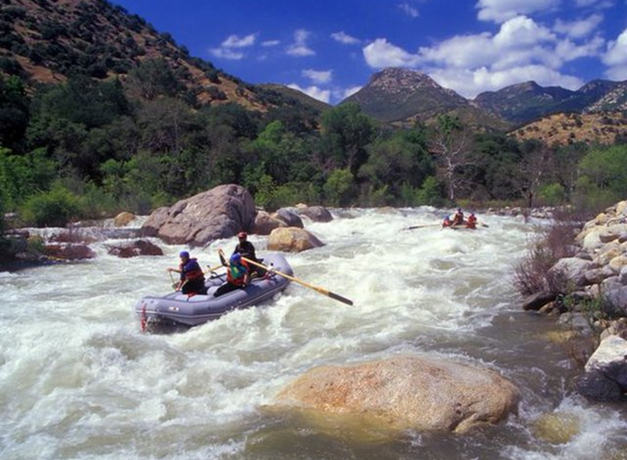 Rafting the Kaweah River when the rapids are moderate.